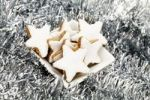 Thumbnail Star-shaped cinnamon cookies in a bowl with Christmas decorations