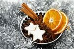 Thumbnail Star-shaped cinnamon cookies with dried slices of orange, cinnamon sticks and Anise stars in a bowl with Christmas decorations