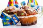 Thumbnail Muffins and paper streamers, symbolic picture for carnival