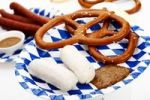 Thumbnail Veal sausages with sweet mustard, salted pretzels, ham Mettwurst sausages and beer