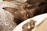 Thumbnail Dark-skinned, 40-year-old woman, lying on a pillow