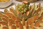 Thumbnail Melons and grapes on a board, buffet