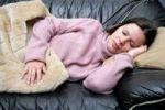 Thumbnail Girl sleeping on a sofa
