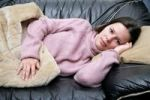 Thumbnail Girl relaxing on a sofa