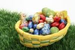 Thumbnail Easter basket with chocolate eggs on grass