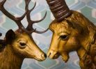 Thumbnail Head of a deer and the head of an ibex, plastic, gazing longingly into each others eyes