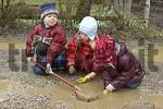 Thumbnail Children are playing during bad weather and rain in puddle and mud sludge