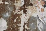 Thumbnail Corroded metal surface with remains of posters