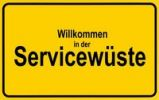 Thumbnail Town sign, German lettering Willkommen in der Servicewueste, symbolic of lack of service
