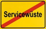 Thumbnail Town exit sign, German lettering Servicewueste, symbolic of end of lack of service