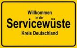 Thumbnail Town sign, German lettering Willkommen in der Servicewueste, symbolic of lack of service in Germany