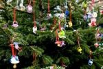 Thumbnail Baby dummies hung up in Christmas tree