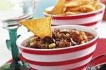 Thumbnail Chili con carne, minced meat, kidney beans, corn, bell pepper, chili and a tortilla chip