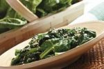 Thumbnail Fresh leaf spinach in a basket and cooked leaf spinach with sesame seeds on a plate