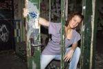 Thumbnail Teenager at a door of an old factory
