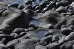 "Thumbnail Round black stones on a rocky coast, ""Paisaje protegido del Remo"" Nature Reserve, La Palma, Canary Islands, Spain"