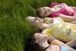 Thumbnail Three girls sleeping in the grass