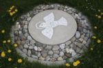 Thumbnail Peace dove made of stone mosaic in a meadow
