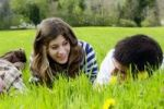 Thumbnail Young people, students, lying on a spring meadow, talking to each other, France, Europe