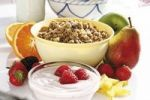 Thumbnail Fruit muesli with yoghurt, raspberries, strawberries, pear, apple, oranges, carambola