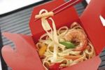 Thumbnail Takeaway noodles with scampsi, bell pepper strips and chopsticks