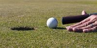 Thumbnail Putting differently, golf club is used as a billiard cue