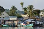 Thumbnail Fishing boats and quaint fishing village with simple colorful wooden houses and palm trees, Phu Quoc, Vietnam, Asia