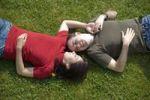 Thumbnail Love couple lying in meadow