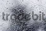 Thumbnail Waterdrops trickle on a glass pane