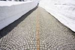 Thumbnail Cobblestone paving of the old Gotthard road between high walls of snow, Switzerland, Europe