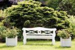 Thumbnail White garden bench in the garden