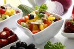 Thumbnail Greek salad with onions, tomatoes, capsicum, feta and olives in small bowls
