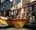 Thumbnail Boat in front of a shop, Nova Scotia, Canada