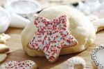 Thumbnail Star-shaped shortcrust cookie with sugar pearls, baking scene with ball of dough