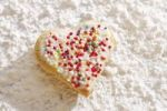 Thumbnail Heart-shaped shortcrust cookie with sugar pearls on powdered sugar