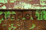 Thumbnail green paint and rust on an container
