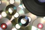 Thumbnail Compact discs and vinyl record, abstract background