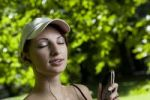 Thumbnail Young woman with ipod