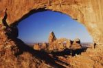 Thumbnail Turret Arch seen through North Window at sunrise with tourists, Arches National Park, Utah, USA