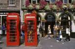 Thumbnail telephone boxes in front of Deacon Brodies tavern on Highstreet, Edinburgh, Scotland