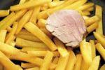 Thumbnail Turnip chips in a pan with a slice of pork fillet