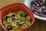 Thumbnail Plums being pitted and halved for a cake