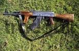 Thumbnail Kalashnikov or AK 47 lying on a meadow