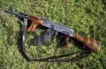 Thumbnail Kalashnikov or AK 47 lying on a meadow