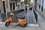Thumbnail Orange Vespa leaning on a railing, Chiado district of Lisbon, Portugal, Europe