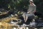 Thumbnail Male, mid 40s, sitting in a stream and surfing the internet, Hoellbach, Black Forest, Germany, Europe