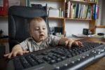 Thumbnail Boy, 10 months, using a pc keyboard