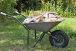 Thumbnail Lumber for firewood in a wheelbarrow