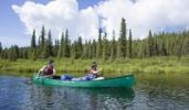 Thumbnail Couple, man and woman, canoeing, paddling, upper Liard River, Caribou Creek, Yukon Territory, Canada