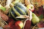 Thumbnail Colorful autumn decoration in a wooden box, pumpkins, apples, pears, ornamental corn and autumn leaves